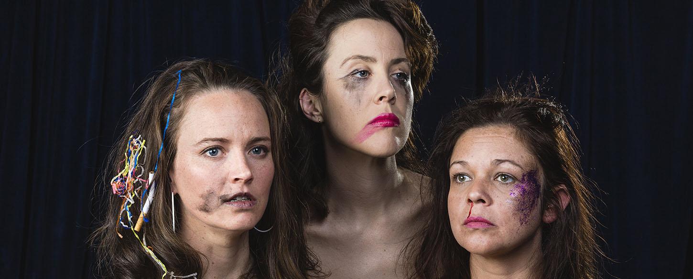 Headshots of three women with garish make up