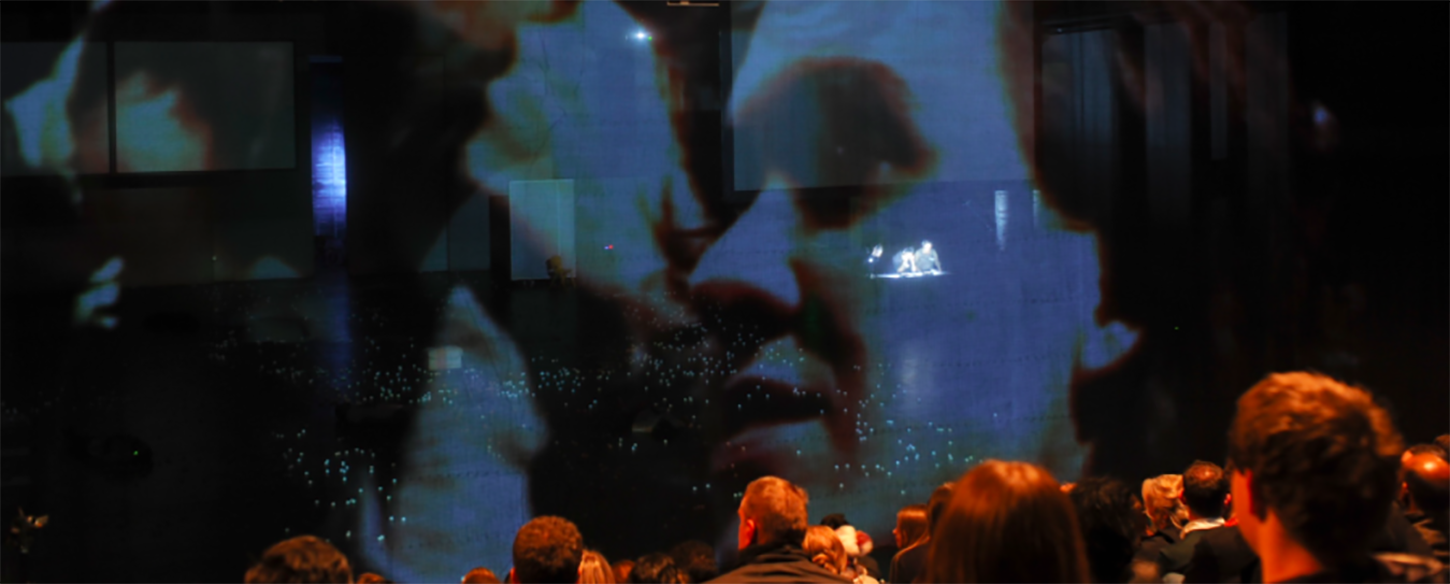 an audience look at a projection onscreen
