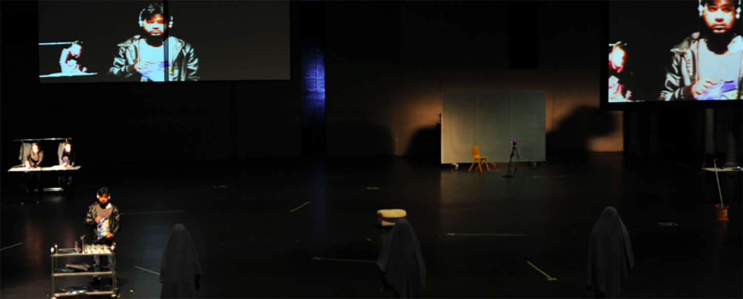 a large stage with projections and performers
