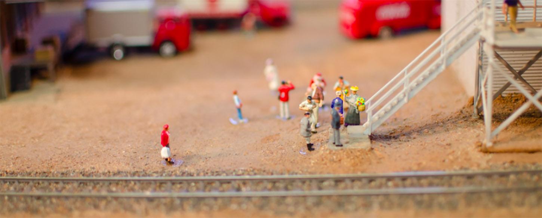 miniature figures on a toy train set